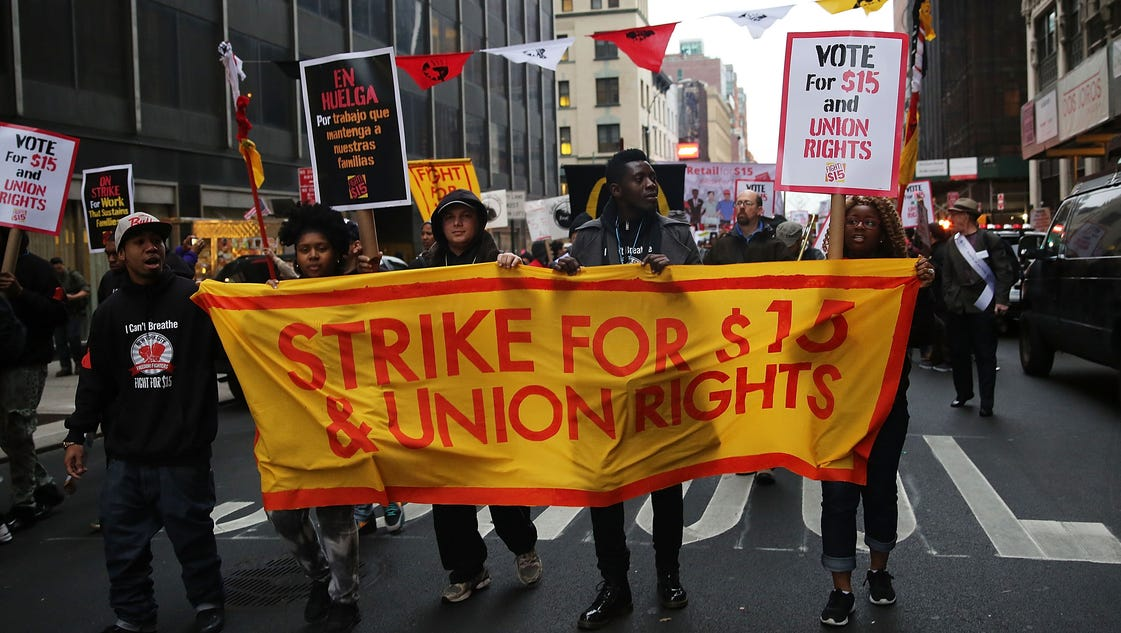 Fast-food workers strike, seeking $15 wage, political muscle