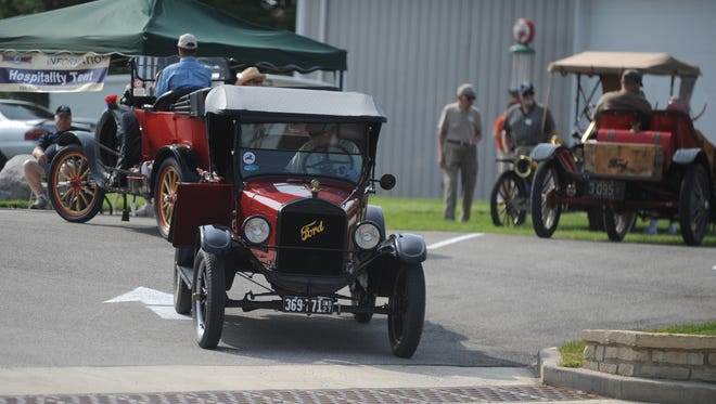 Model T Ford owners line up for a driving tour to Metamora.