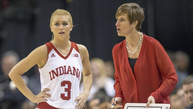IU coach Teri Moren talks with Tyra Buss during the Hoosiers' loss to Northwestern Friday in the women's Big Ten tournament.