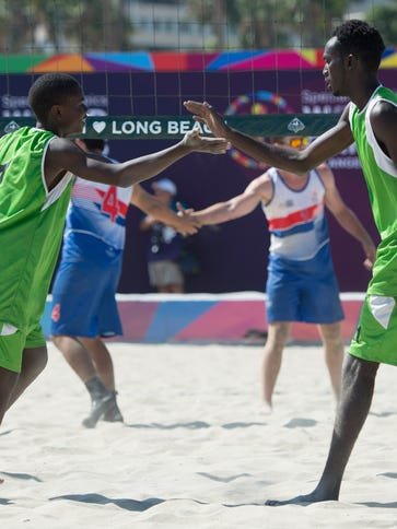 Kenya's Joseph Njunie, left, and Victor Masila celebrate