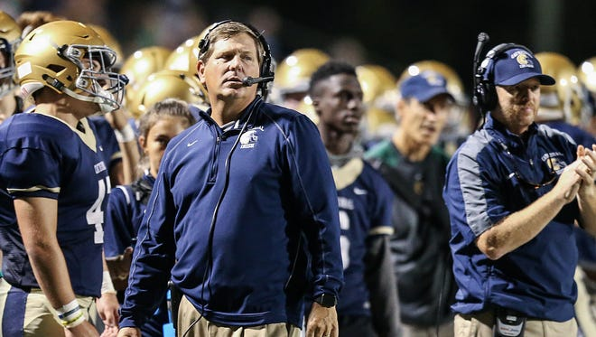 Cathedral Fighting Irish head coach Rick Streiff watches second quarter action between Cathedral and Center Grove at Arsenal Technical High School, Indianapolis, Friday, Oct. 13, 2017. Cathedral led at halftime, 14-0.