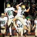 Forcing fumbles, Fighting Irish power over Bermudian, 41-26.