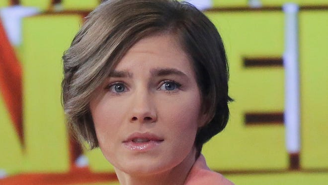 Amanda Knox prepares to leave the set after a television interview Friday in New York. Knox said she will fight the  guilty verdict against her and an ex-boyfriend in the slaying of a British roommate in 2007 in Italy.