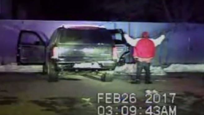 A still image from a Green Bay police car's dash camera of a Feb. 26 traffic stop in which investigators determined officers used excessive force while arresting an unarmed man.