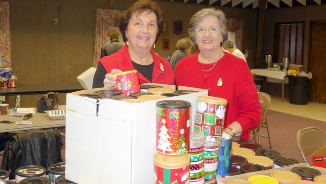 Diane Ragone (left) and Barbara McMahon are co-chairs of the Woman's Club of Vineland Cookie/Candy Project, which benefits the residents of the New Jersey Veterans Memorial Home in Vineland. Club members filled more than 300 cans for this year's project.