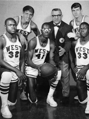 The Rockford West High School Warriors' 28-game victory streak ended March 18, 1967 in the stae semifinals. Members of the '66-'67 team included Calvin Glover (left to right), Mark Sibley, Cliff Perteete, Coach Alex Saudargas, Steve Amidon (standing right) and Jim Sallis.