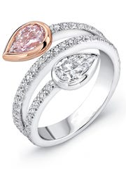 """A rare pink pear-shaped diamond is paired with white diamonds in Craig Slavens' """"bypass"""" ring design."""