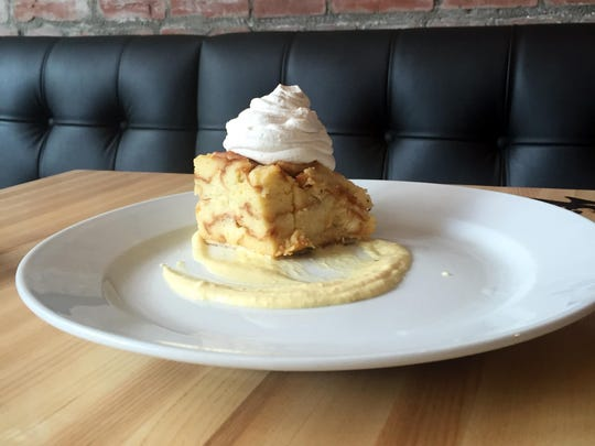 White chocolate bread pudding with a bourbon creme anglaise at Louie's Wine Dive on Mass Ave.