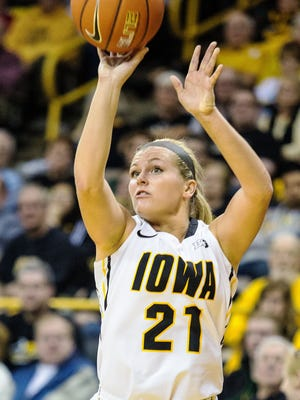 Iowa's Melissa Dixon (21) puts up a jump shot against Penn State during the first half of play at Carver-Hawkeye Arena in Iowa City on Sunday, December 28, 2014. The Hawkeyes opened the Big Ten season with at 77-52 win over the Nittany Lions.