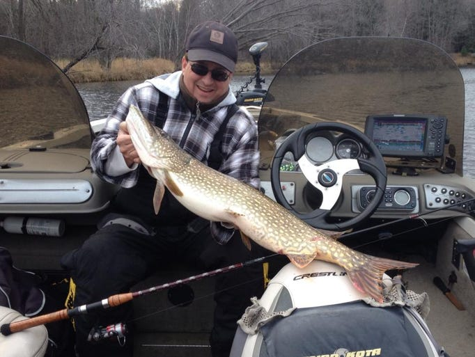 Kevin Munson with a Northern pike caught with Hooksetters