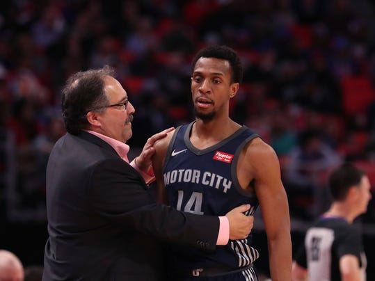 Detroit Pistons head coach Stan Van Gundy, left, talks with guard Ish Smith during the second half of an NBA basketball game against the Toronto Raptors, Monday, April 9, 2018, in Detroit. (AP Photo/Carlos Osorio)