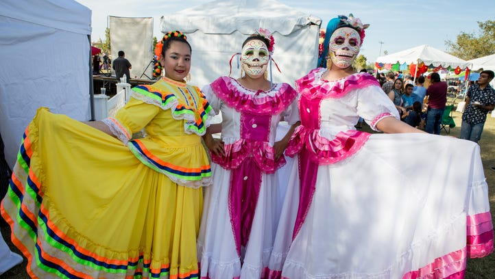 These dancers wore beautiful dresses at Dia de los