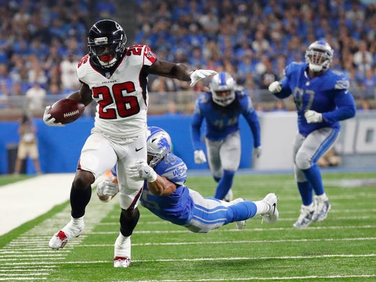 FILE - In this Sept. 24, 2017, file photo, Atlanta Falcons running back Tevin Coleman (26) is tackled by Detroit Lions strong safety Miles Killebrew (35) during the first half of an NFL football game in Detroit. When the first-place New Orleans Saints face the Atlanta Falcons on Thursday night in an NFC South matchup with serious playoff ramifications, the spotlight will be on the guys in the backfield. (AP Photo/Rick Osentoski, File)