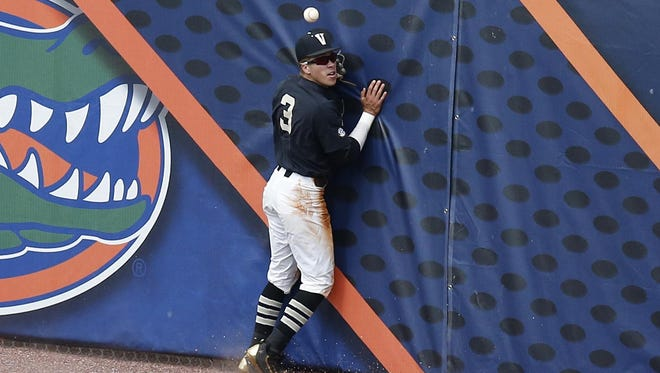 Vanderbilt outfielder Jeren Kendall fails to catch a fly ball hit by Texas A&M's Hunter Melton during the first inning Friday.