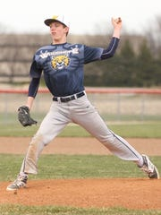 Woodmore's Taityn Rollins throws a pitch against SJCC