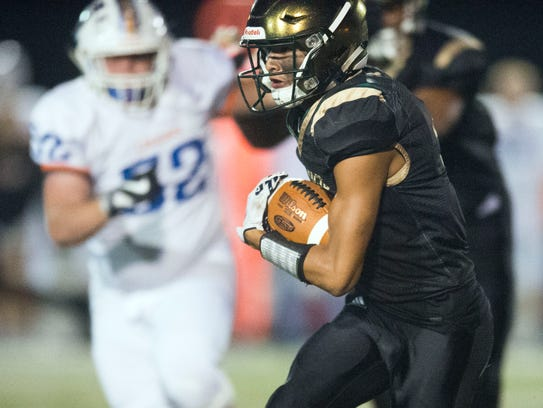 Knoxville Catholic's Dashon Bussell attempts to gain