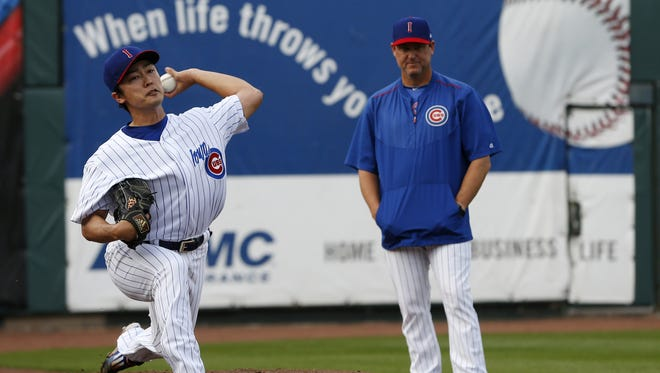 Iowa Cubs pitcher Tsuyoshi Wada warms up in the bull pen Friday, April 17, 2015 before the Iowa Cubs home opener at Principal Park in Des Moines.