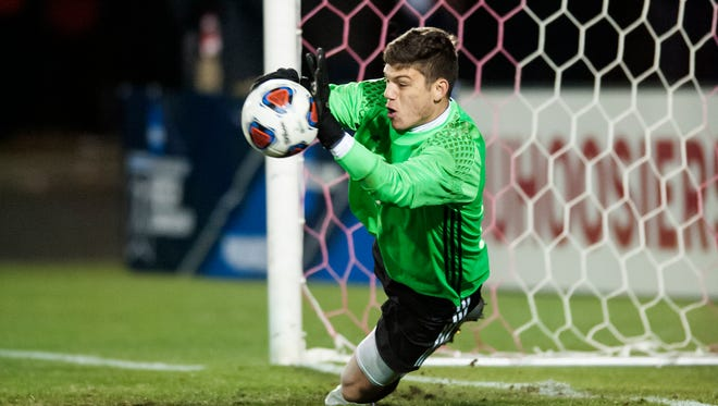 Indiana goalkeeper Trey Muse (1) blocks a penalty kick during the shootout at an NCAA college soccer game against Michigan State in Bloomington, Ind. Friday, Dec. 1, 2017.
