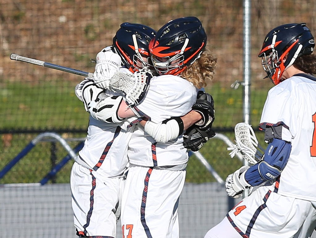 From left, Briracliff's Michael DeGasperis (2) jumps into the arms of teammate Peter Olson (17) after a 4th quarter goal against Pleasantville during a lacrosse game at Briarcliff High School April 20, 2016. Briarcliff won the game 8-7.
