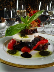 A grilled eggplant tower with goat cheese, roasted peppers, portobello mushrooms and balsamic glaze at Whispers in Spring Lake.