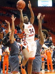 UTEP's Lawna Kennedy, 34, reaches for a shot against Florida Atlantic on Saturday in the Don Haskins Center. Miners defeated FAU 75-47 to remain in first in Conference USA. See more photos at elpasotimes.com.