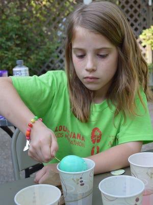 Amelia Losavio, 8, dyes hard-boiled eggs for Easter.