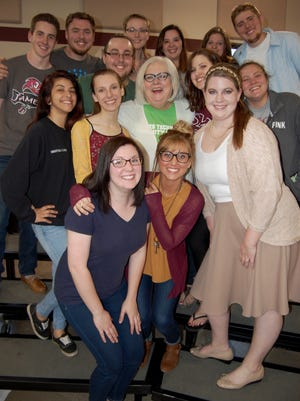 Photo is of Alberta with some of her OTC Choir members