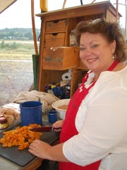 Hearty meals are downed at the chuckwagons.
