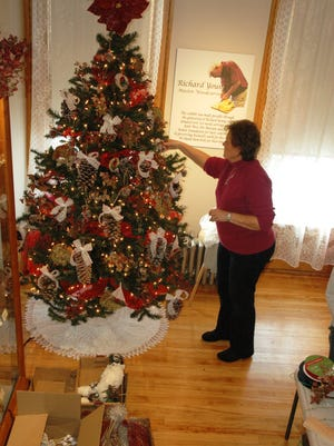 "Susan Hoppe decorates a Christmas tree for ""Christmas in the Mansion"" at Vilas Rahr Mansion. The event runs Nov. 23-Jan. 8."