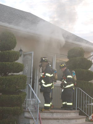 A two alarm fire in Garfield Friday morning left two firefighters injured.