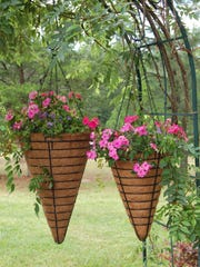 For easy care, group hanging baskets and other container-grown plants in shady areas with easy access to water