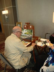 Painter Cedric Hustace demonstrates his style of artwork