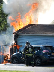 Firefighters battle a blaze in a single-family home on Beucler Place in Bergenfield on Sunday morning.
