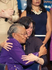 Recy Taylor, left, and Danielle McGuire embrace during a National Press Club event in 2011 in Washington D.C.