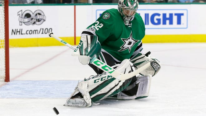 Dallas Stars goalie Kari Lehtonen (32) deflects a shot during the second period of an NHL hockey game against the San Jose Sharks in Dallas, Friday, March 24, 2017. (AP Photo/LM Otero)