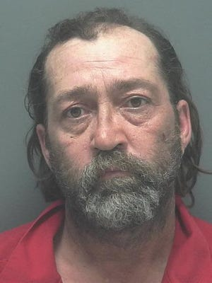 Kevin Peter, 53, was arrested on assault charges after firing a gun toward a vehicle