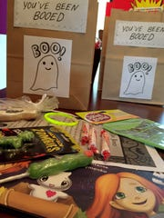 """Kendra Montante stuffs boo bags full of treats at her West Bloomfield home. She wrote """"Booing: A Halloween Tradition."""""""