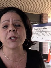 Toni Massafra of Hartsdale talks about the Metro-North cheating scandal while waiting for a train Thursday in White Plains.