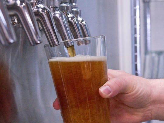 An IPA fills a glass pint.