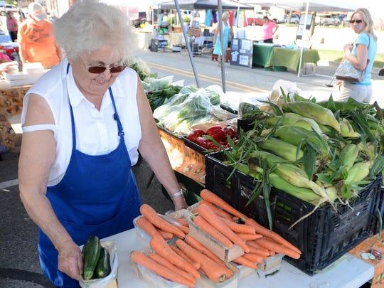 Gloria McDermott prepares to sell some farm-fresh veggies