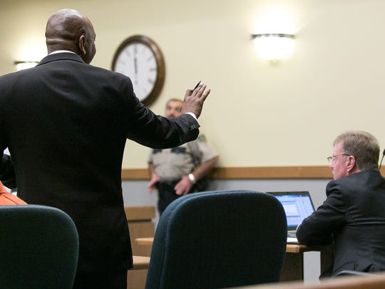 Joshua Boone, defense attorney representing Anthony Cobos, left, and District Attorney Mark D'Antonio, far right, have a brief yet heated exchange Friday during sentencing at 3rd Judicial District Court.