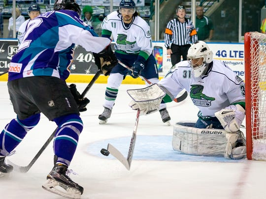 Everblades goalie Daniel Altshuller makes a save against Orlando forward Ben Johnson in the second period on Monday, April 27, 2015, in Estero.