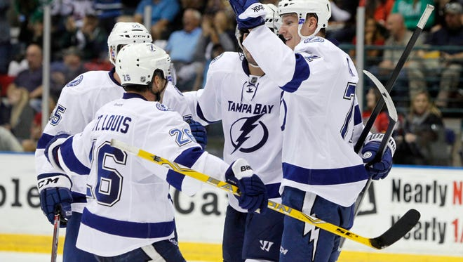Tampa Bay Lightning right wing Richard Panik (71) is congratulated by teammates after he scored a goal against the Florida Panthers during the third period at Germain Arena. Tampa Bay Lightning defeated the Florida Panthers 3-2 in overtime.