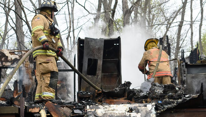 Ashland City and Pleasant View firefighters control Monday's fire on Beech Grove Road in Ashland City.