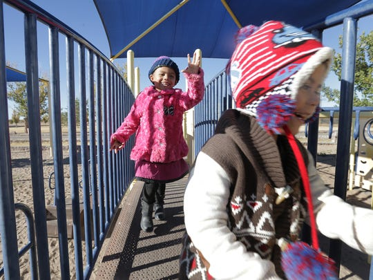 Ariel Morales, 4, chases her little brother, Eddie Jr., around the playground at Gallegos Park in Canutillo.