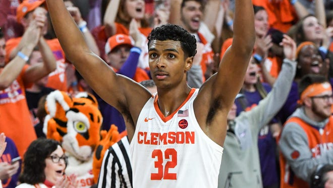 Clemson forward Donte Grantham (32) celebrates in the closing second of a 72-63 win over Miami at Littlejohn Coliseum in Clemson on Saturday.
