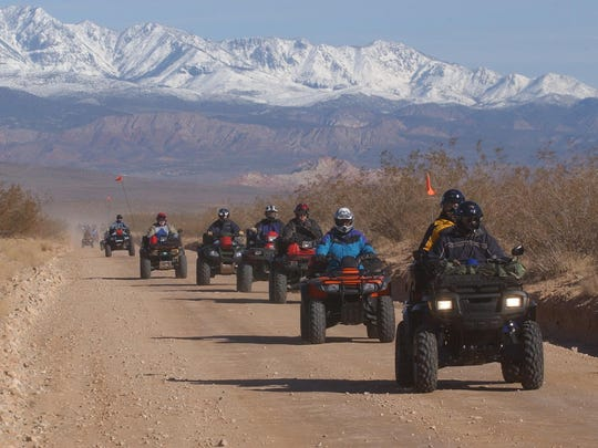 A group of ATV enthusiasts head south out of Hurricane in this photo from May 31, 2014.