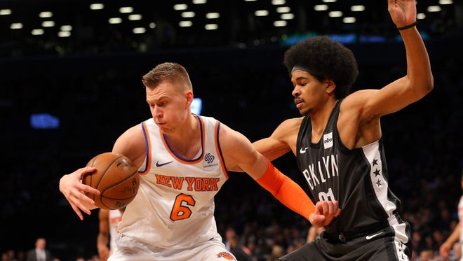 New York Knicks power forward Kristaps Porzingis (6) plays the ball against Brooklyn Nets center Jarrett Allen (31) during the first quarter at Barclays Center.
