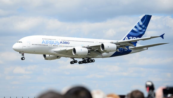 An Airbus A380 painted in the jetmaker's signature color scheme flies at the Farnborough Air Show in England on July 15, 2014.