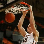 OSU's Angus Brandt gets a dunk during the first half of a first round loss in the College Basketball Invitational.